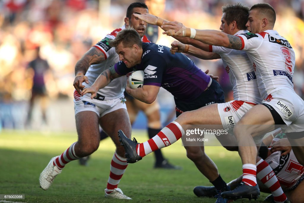 Cameron Munster of the Storm is tackled during the round nine NRL match between the St George Illawarra Dragons and the Melbourne Storm at WIN Stadium on April 30, 2017 in Wollongong, Australia.