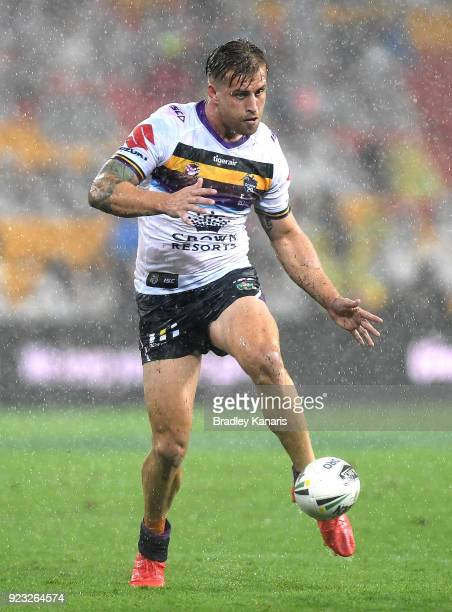 Cameron Munster of the Storm kicks the ball during the NRL trial match and Jonathan Thurston/Cameron Smith Testimonial match between the Melbourne...