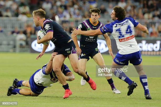 Cameron Munster of the Storm looks to pass the ball during the round one NRL match between the Canterbury Bulldogs and the Melbourne Storm at Perth...