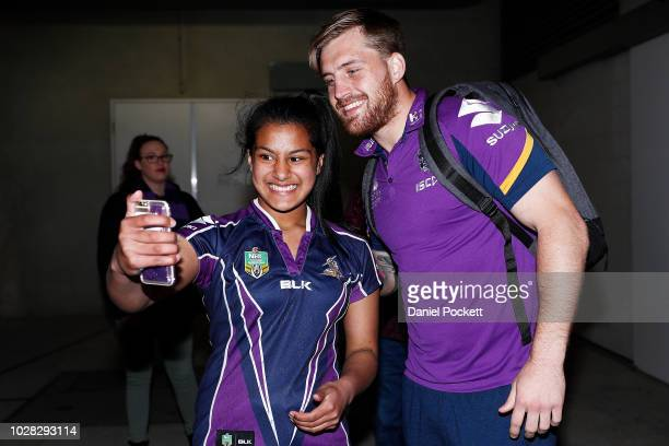 Cameron Munster of the Storm poses for a selfie with a fan ahead of the NRL Qualifying Final match between the Melbourne Storm and the South Sydney...