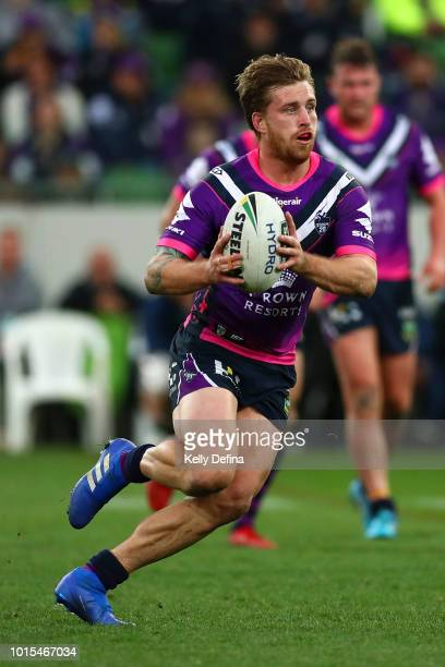 Cameron Munster of the Storm runs with the ball during the round 22 NRL match between the Melbourne Storm and the Cronulla Sharks at AAMI Park on...