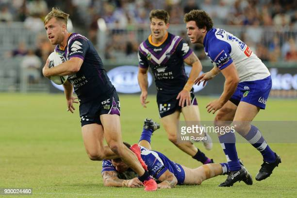 Cameron Munster of the Storm shakes a tackle during the round one NRL match between the Canterbury Bulldogs and the Melbourne Storm at Perth Stadium...