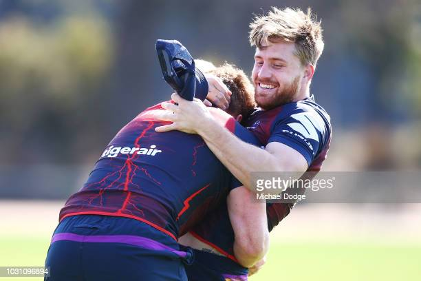 Cameron Munster of the Storm wretsles during a Melbourne Storm NRL training session at Gosch's Paddock on September 11 2018 in Melbourne Australia