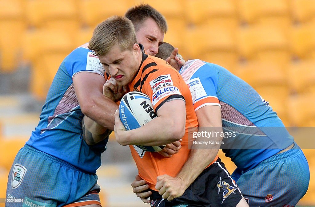 Cameron Munster of the Tigers attempts to break through the defence during the Intrust Super Cup Grand Final match between Northern Pride and Easts Tigers at Suncorp Stadium on September 28, 2014 in Brisbane, Australia.