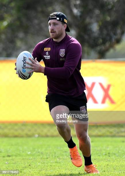 Cameron Munster runs with the ball during a Queensland Maroons State of Origin training session at Sanctuary Cove on July 5 2018 in Gold Coast...