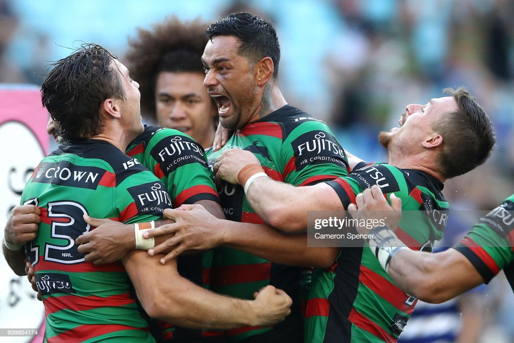 Cameron Murray of the Rabbitohs celebrates with John Sutton of the Rabbitohs and team mates after scoring a try during the round four AFL match between the South Sydney Rabbitohs and the Canterbury Bulldogs at ANZ Stadium on March 30, 2018 in Sydney, Australia.