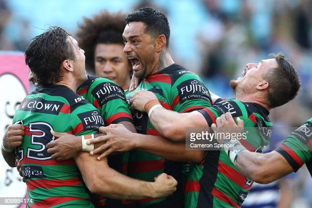 Cameron Murray of the Rabbitohs celebrates with John Sutton of the Rabbitohs and team mates after scoring a try during the round four AFL match...