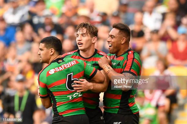 Cameron Murray of the Rabbitohs celebrates with team mates after scoring a try during the round nine NRL match between the South Sydney Rabbitohs and...