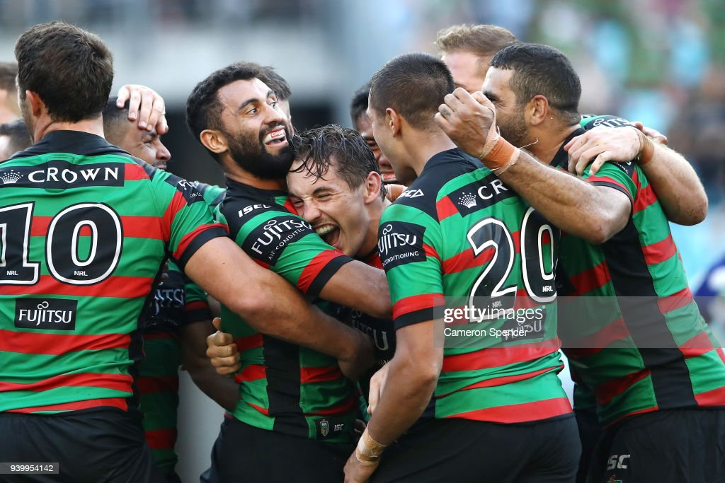 Cameron Murray of the Rabbitohs celebrates with team mates after scoring a try during the round four AFL match between the South Sydney Rabbitohs and the Canterbury Bulldogs at ANZ Stadium on March 30, 2018 in Sydney, Australia.
