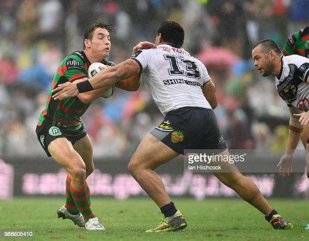Cameron Murray of the Rabbitohs is tackled by Jason Taumalolo of the Cowboys during the round 16 NRL match between the South Sydney Rabbitohs and the...
