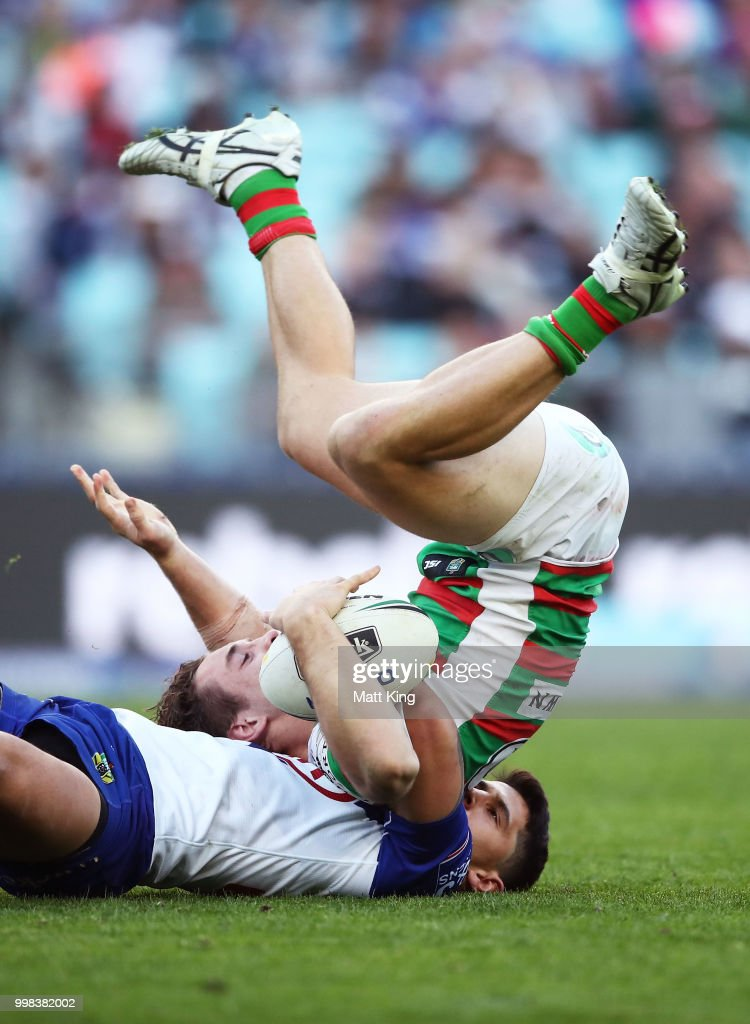 Cameron Murray of the Rabbitohs is tackled by Jeremy Marshall-King of the Bulldogs during the round 18 NRL match between the Canterbury Bulldogs and the South Sydney Rabbitohs at ANZ Stadium on July 14, 2018 in Sydney, Australia.