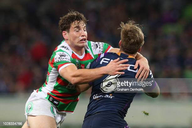 Cameron Murray of the Rabbitohs tackles Cameron Munster of the Storm during the NRL Qualifying Final match between the Melbourne Storm and the South...