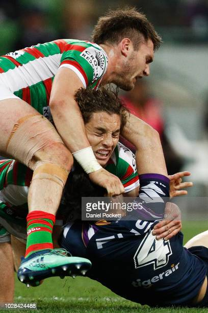 Cameron Murray of the Rabbitohs tackles Curtis Scott of the Storm uring the NRL Qualifying Final match between the Melbourne Storm and the South...
