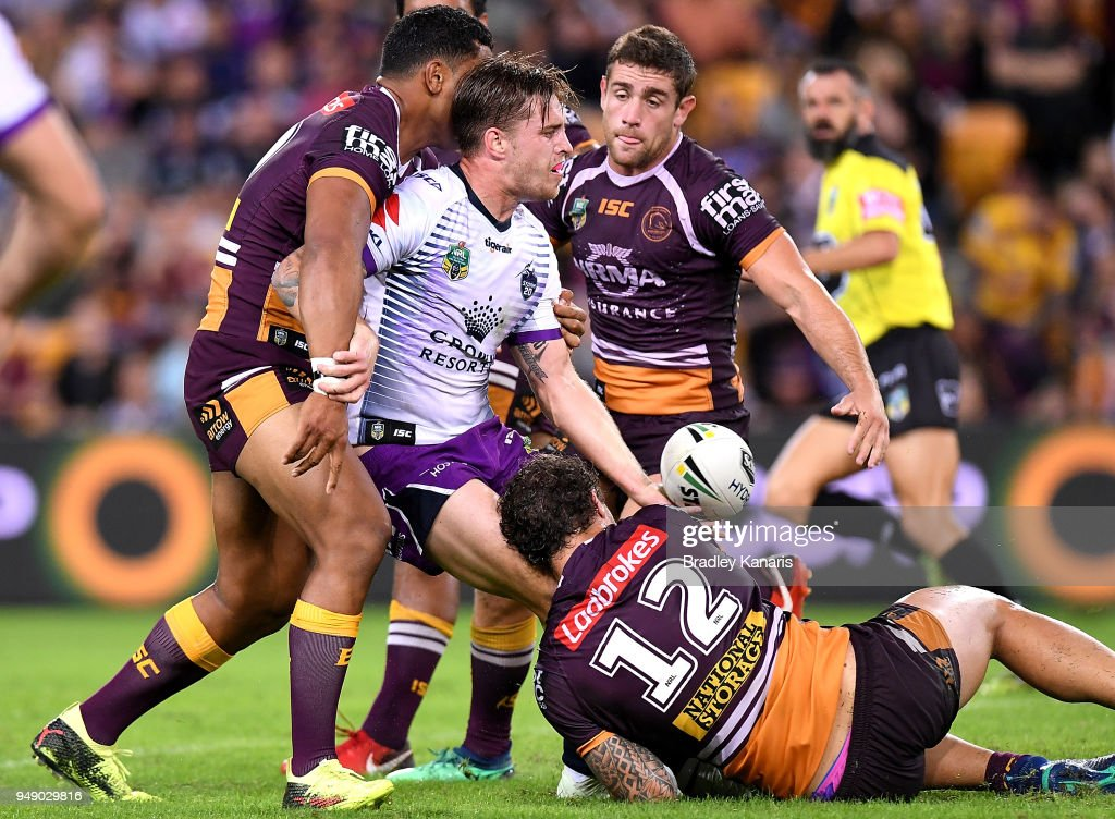 Cameron Muster of the Storm offloads during the round seven NRL match between the Brisbane Broncos and the Melbourne Storm at Suncorp Stadium on April 20, 2018 in Brisbane, Australia.