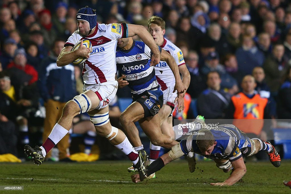 Cameron Neild (L) of Sale bursts through the challenge of Stuart Hooper of Bath during the Aviva Premiership match between Bath Rugby and Sale at the Recreation Ground on March 6, 2015 in Bath, England.