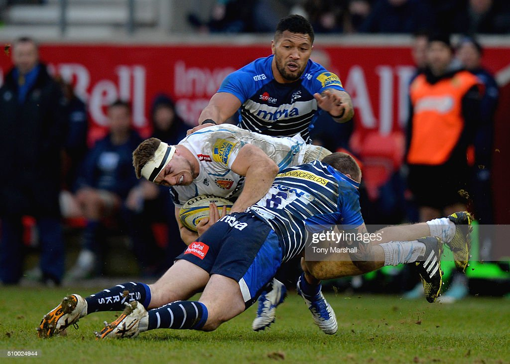 Cameron Neild of Sale Sharks tackles Ian Whitten of Exeter Chiefs during the Aviva Premiership match between Sale Sharks and Exeter Chiefs at the A J Bell Stadium on February 13, 2016 in Salford, England