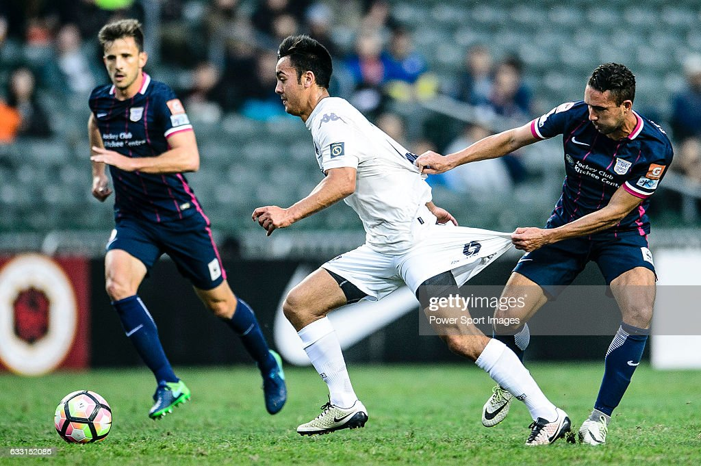 Cameron Neru of Auckland City (L) battles with SC Kitchee Midfielder Fernando Augusto (C) during the 2017 Lunar New Year Cup match between SC Kitchee (HKG) and Auckland City FC (NZL) on January 31, 2017 in Hong Kong, Hong Kong.