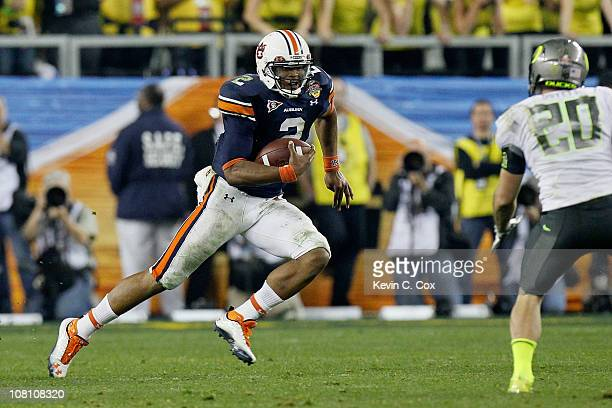 Cameron Newton of the Auburn Tigers runs down field against John Boyett of the Oregon Ducks during the Tostitos BCS National Championship Game at...