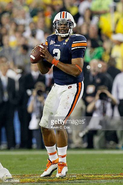 Cameron Newton of the Auburn Tigers scrambles against the Oregon Ducks during the Tostitos BCS National Championship Game at University of Phoenix...