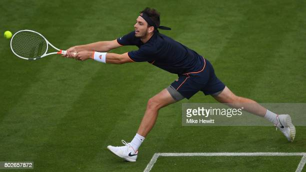 Cameron Norrie of GBR is made to stretch by Gael Monfils of France during Day 4 of the Aegon International Eastbourne tournament at Devonshire Park...