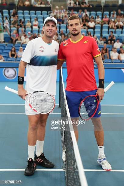 Cameron Norrie of Great Britain and Alexander Cozbinov of Moldova pose ahead of their Group C singles match during day five of the 2020 Sydney...