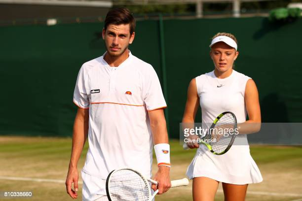Cameron Norrie of Great Britain and Katie Swann of Great Britain look on during the Mixed Doubles first round match against Mikhail Elgin of Russia...