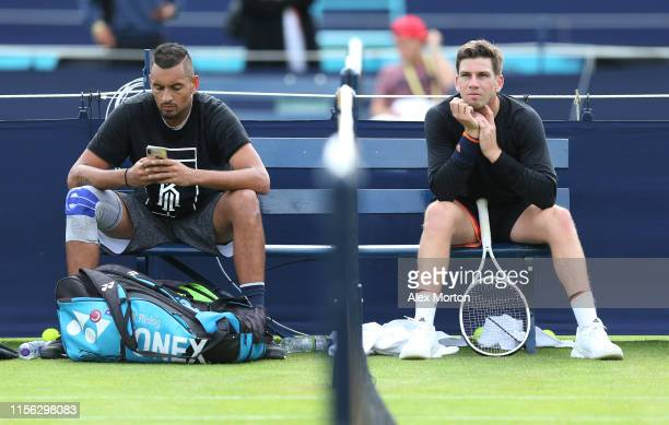 Cameron Norrie of Great Britain and Nick Kyrgios of Australia during a practice session prior to the FeverTree Championships at Queens Club on June...