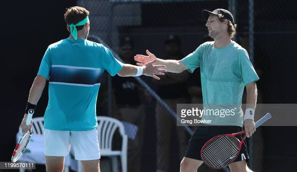 Cameron Norrie of Great Britain and Rhett Purcell of New Zealand celebrate a point against Rohan Bopanna of India and Henri Kontinen of Finland...
