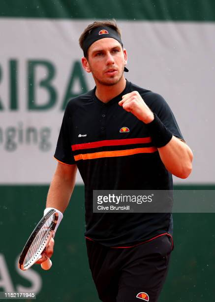 Cameron Norrie of Great Britain celebrates during his mens singles first round match against Elliot Benchetrit of France during Day three of the 2019...
