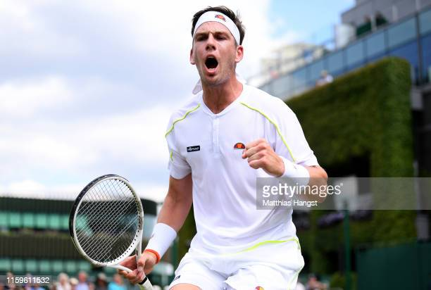 Cameron Norrie of Great Britain celebrates in his Men's Singles first round match against Denis Istomin of Uzbekistan during Day two of The...