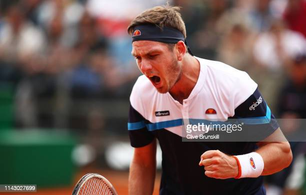 Cameron Norrie of Great Britain celebrates match point against Adrian Mannarino of France in their first round match during day 3 of the Rolex...