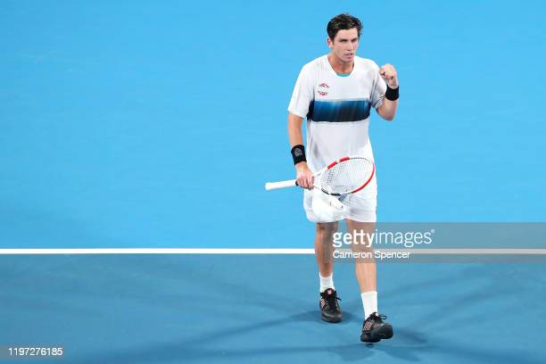 Cameron Norrie of Great Britain celebrates winning match point during his Group C singles match against Dimitar Kuzmanov of Bulgaria during day one...
