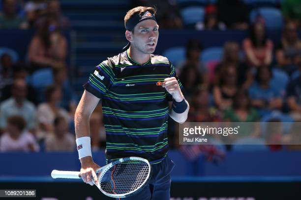 Cameron Norrie of Great Britain celebrates winning the first set in his singles match against Frances Tiafoe of the United States during day six of...