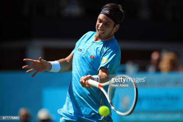 Cameron Norrie of Great Britain hits a forehand during his match against Stan Wawrinka of Switzerland on Day 1 of the FeverTree Championships at...