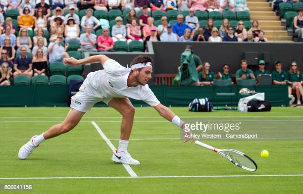 Cameron Norrie of Great Britain in action against JoWilfred Tsonga of France in their Men's Singles First Round Match at All England Lawn Tennis and...