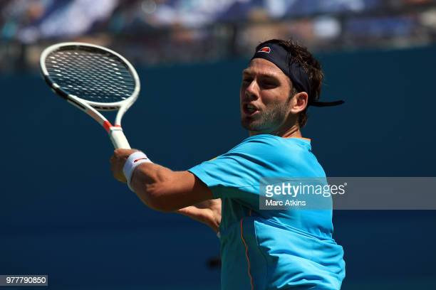 Cameron Norrie of Great Britain in action with Stan Wawrinka of Switzerland on Day 1 of the FeverTree Championships at Queens Club on June 18 2018 in...