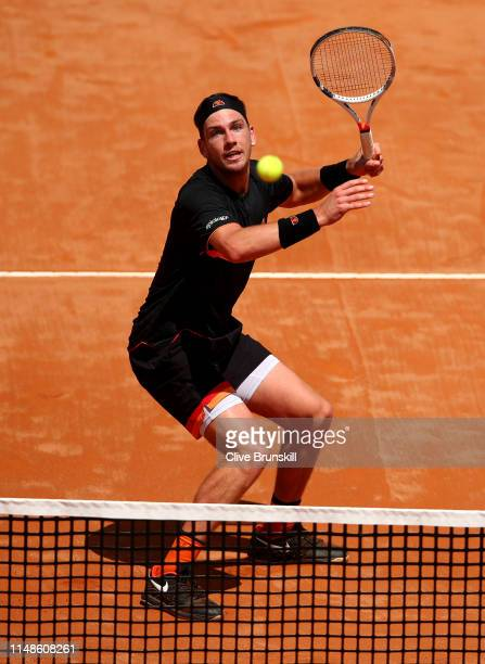 Cameron Norrie of Great Britain lines up to play a smash in the final quqlifying round against Nicolas Jarry of Chile during day one of the...