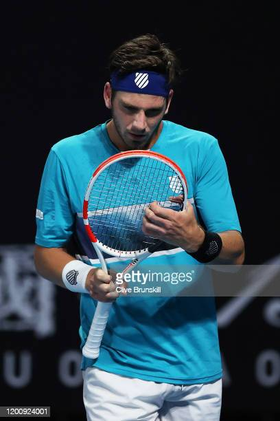 Cameron Norrie of Great Britain looks at his racquet during his Men's Singles first round match against PierreHugues Herbert of France on day two of...