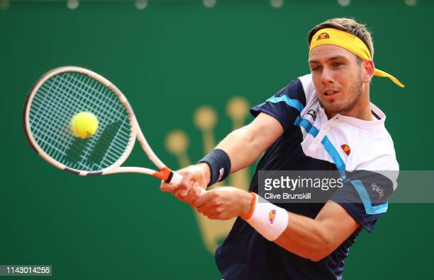 Cameron Norrie of Great Britain plays a backhand against Adrian Mannarino of France in their first round match during day 3 of the Rolex MonteCarlo...