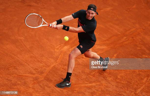 Cameron Norrie of Great Britain plays a backhand against John Millman of Australia in their first round match during day two of the International BNL...