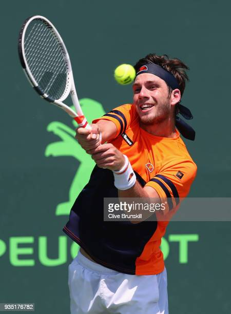 Cameron Norrie of Great Britain plays a backhand against Patrick Kypson of the United States in the final qualifying round during the Miami Open...