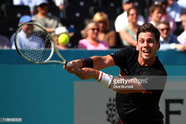 Cameron Norrie of Great Britain plays a backhand during his First Round Singles Match against Kevin Anderson of South Africa during Day One of the...