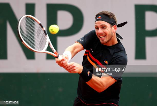 Cameron Norrie of Great Britain plays a backhand during his mens singles first round match against Elliot Benchetrit of France during Day three of...