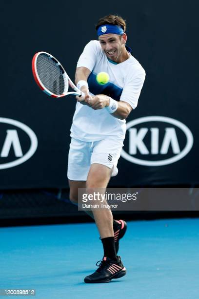Cameron Norrie of Great Britain plays a backhand during his Men's Singles first round match against PierreHugues Herbert of France on day two of the...