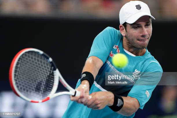 Cameron Norrie of Great Britain plays a backhand during his quarter final singles match against Nick Kyrgios of Australia during day seven of the...