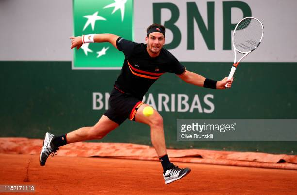 Cameron Norrie of Great Britain plays a forehand during his mens singles first round match against Elliot Benchetrit of France during Day three of...