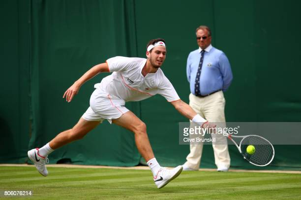 Cameron Norrie of Great Britain plays a forehand during the Gentlemen's Singles first round match against JoWilfried Tsonga of France on day one of...