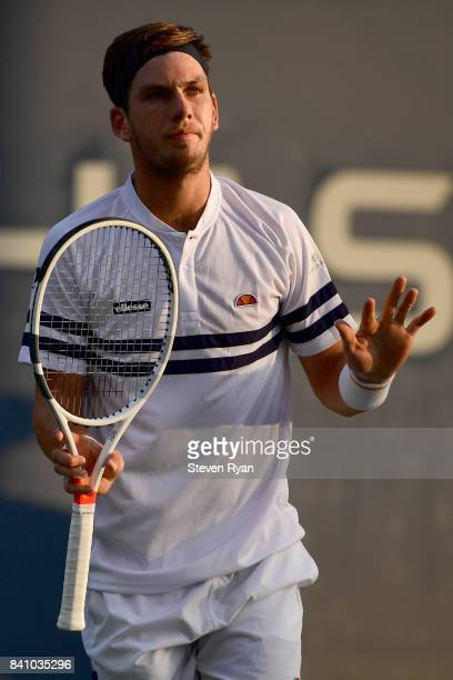 Cameron Norrie of Great Britain reacts against Pablo Carreno Busta of Spain during their second round Men's Singles match on Day Three of the 2017 US...