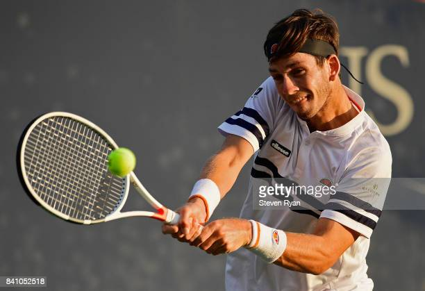 Cameron Norrie of Great Britain returns a shot against Pablo Carreno Busta of Spain during their second round Men's Singles match on Day Three of the...