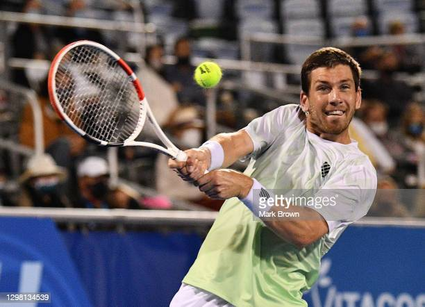 Cameron Norrie of Great Britain returns a shot against Sebastian Korda during the Semifinals of the Delray Beach Open by Vitacost.com at Delray Beach...